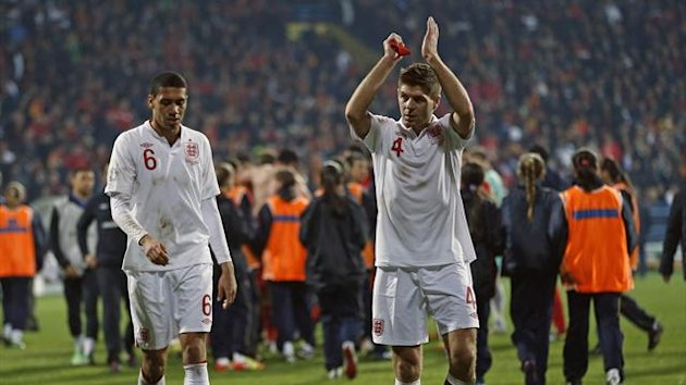 England captain Steven Gerrard (R) salutes the travelling fans after their 2014 World Cup qualifying game against Montenegro. (Reuters)