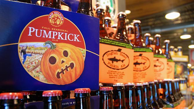 This Friday, Aug. 30, 2013 photo shows pumpkin beers on display for sale at a Whole Foods Market in Richmond, Va. Labor Day may be considered the unofficial end of summer, but some craft brewers couldn't even wait until then to roll out their pumpkin and other fall seasonal beers. Many already have been in stores and on taps for a month. (AP Photo/Michael Felberbaum)
