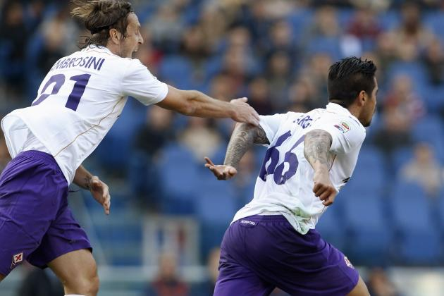 Fiorentina Vargas celebrates with teammate Ambrosini after scoring against AS Roma during their Italian Serie A soccer match at the Olympic stadium in Rome