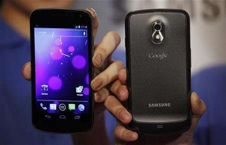 Models pose with the Galaxy Nexus, the first smartphone to feature Android 4.0 Ice Cream Sandwich and a HD Super AMOLED display, during a news conference in Hong Kong October 19, 2011