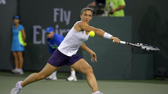 Sara Errani, of Italy, returns a shot to Maria Sharapova, of Russia, during their match at the BNP Paribas Open tennis tournament, Wednesday, March 13, 2013, in Indian Wells, Calif. (AP Photo/Mark J. Terrill)