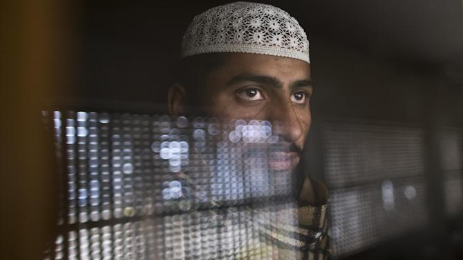 In this Sunday, Feb. 1, 2015 photo, a Pakistani student of a madrassa, or Islamic school, looks out through the window of his classroom at a seminary in Islamabad, Pakistan. There's no exact number of madrassas in Pakistan but estimates put the number in the tens of thousands. They provide food, housing and a religious education to students from around the country. Many teach both male and female students. (AP Photo/Muhammed Muheisen)