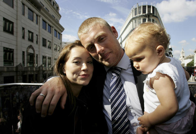 LONDON - SEPTEMBER 13:  (l-r) Rachael Flintoff, Andrew Flintoff and their daughter Holly pose for a photograph aboard the parade bus in Trafalgar Square as part of the Ashes victory celebration, Septe
