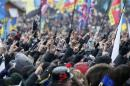 People gesture during a rally organized by supporters of EU integration at Maidan Nezalezhnosti or Independence Square in central Kiev