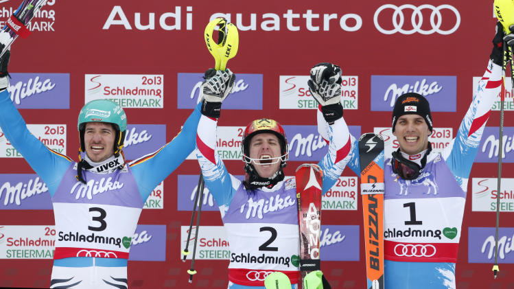 Austria's gold medal winner Marcel Hirscher is flanked by Germany's silver medal winner Felix Neureuther, left, and Austria's bronze medalist Marcel Hirscher after the second run of the men's slalom at the Alpine skiing world championships in Schladming, Austria, Sunday, Feb.17,2013. (AP Photo/Matthias Schrader)