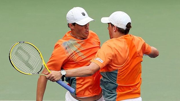 Mike Bryan (R) and Bob Bryan of the United States celebrate with a chest bump at the US Open (AFP)
