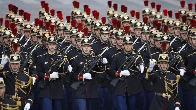 Republican guards parade down the Champs Elysees, during the traditional Bastille Day parade in Paris, Thursday July 14, 2011. (AP Photo/Remy de la Mauviniere)