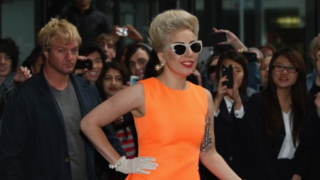 Lady Gaga greets fans as she arrives at the Stamford Plaza in Auckland, New Zealand on June 5, 2012  -- Getty Images