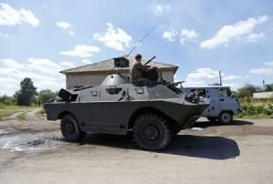 A pro-Russian separatist drives an armoured vehicle …