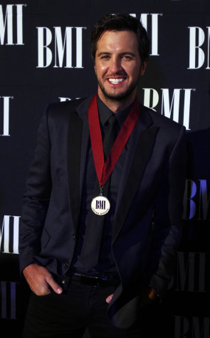 Luke Bryan arrives at the 60th Annual BMI Country Awards on Tuesday Oct. 30, 2012, in Nashville, Tenn. (Photo by Wade Payne/Invision/AP)
