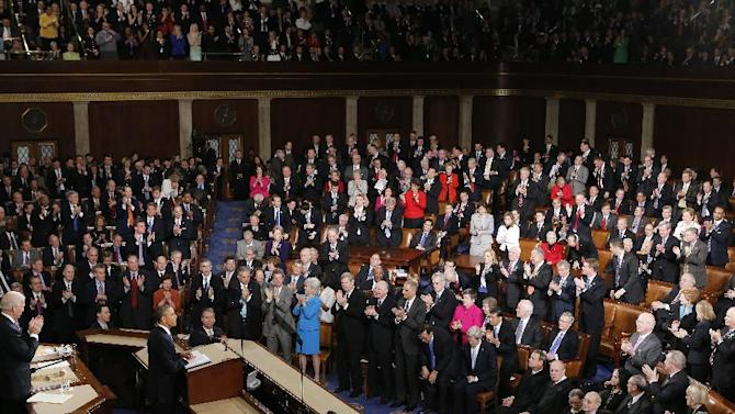 President Barack Obama is applauded as he gives his State of the Union address during a joint session of Congress on Capitol Hill in Washington, Tuesday Feb. 12, 2013. (AP Photo/J. Scott Applewhite)