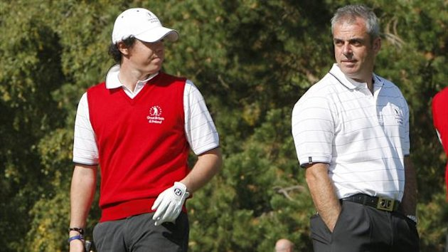 Northern Ireland golfer Rory McIlroy (L) chats with his team captain Paul McGinley during the Vivendy Trophy in 2009 (AFP)
