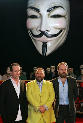 "In this April 17, 2006 photo, ""V for Vendetta"" director James McTeigue, left, producer Joel Silver, center, and actor Hugo Weaving pose for photographers as they are greeted by Japanese fans, all wearing the masks in the movie, upon their arrival at the Japan Premier of their latest film in Tokyo. Television audiences across China watched an anarchist antihero rebel against a totalitarian government and persuade the people to rule themselves. Soon the Internet was crackling with quotes of ""V for Vendetta's"" famous line: ""People should not be afraid of their governments. Governments should be afraid of their people."" The airing of the movie Friday night, Dec. 14, 2012 on China Central Television stunned viewers and raised hopes that China is loosening censorship. (AP Photo/Shizuo Kambayashi)"