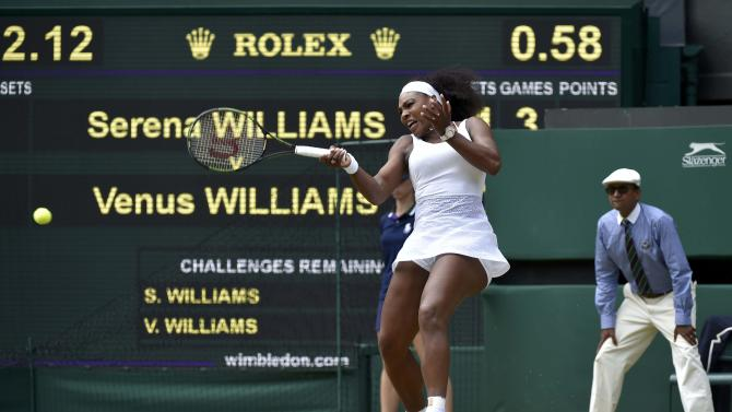Serena Williams of the U.S.A. hits a shot during her match against Venus Williams of the U.S.A. at the Wimbledon Tennis Championships in London