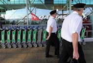 Qantas pilots arrive for work at Sydney Airport in 2011. Flagship Australian airline said on Thursday it was ditching the BlackBerry for Apple&#39;s iPhone after strong demand from staff, deepening woes for troubled Canadian maker Research in Motion