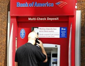 A customer stands at an ATM machine at a Bank of America office in Burbank, California