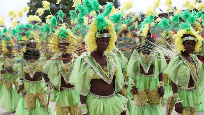 Performers dance through the streets during Lagos Carnival in Lagos, Nigeria,  Monday, April 1, 2013. Performers filled the streets of Lagos' islands Monday as part of the Lagos Carnival, a major festival in Nigeria's largest city during Easter weekend. (AP Photo/Sunday Alamba)
