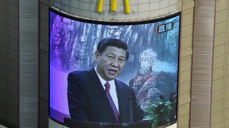 A mall screen shows Chinese Communist Party new General Secretary Xi Jinping speak at a press conference in Beijing Thursday Nov. 15, 2012. Xi became leader of China on Thursday, securing the Communist Party's top spot and oversight of the military in a political transition upset by scandals that have added fuel to public demands for change as the country faces slower economic growth. (AP Photo/Lee Jin-man)
