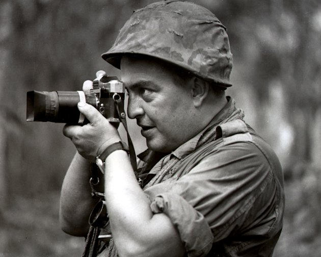 FILE - In this 1967 file photo Associated Press photographer Horst Faas works in Vietnam. Faas, a prize-winning combat photographer who carved out new standards for covering war with a camera and beca