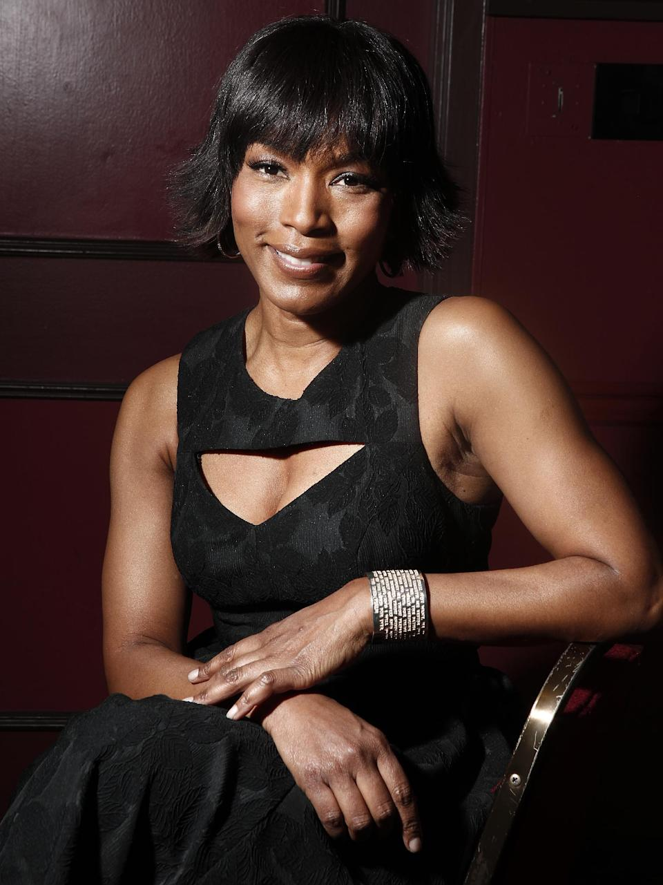 "FILE - This Jan. 12, 2012 file photo shows actress Angela Bassett at Sardi's restaurant in New York. Bassett co-stars in the action flick, ""Olympus Has Fallen.""   (AP Photo/Carlo Allegri, file)"