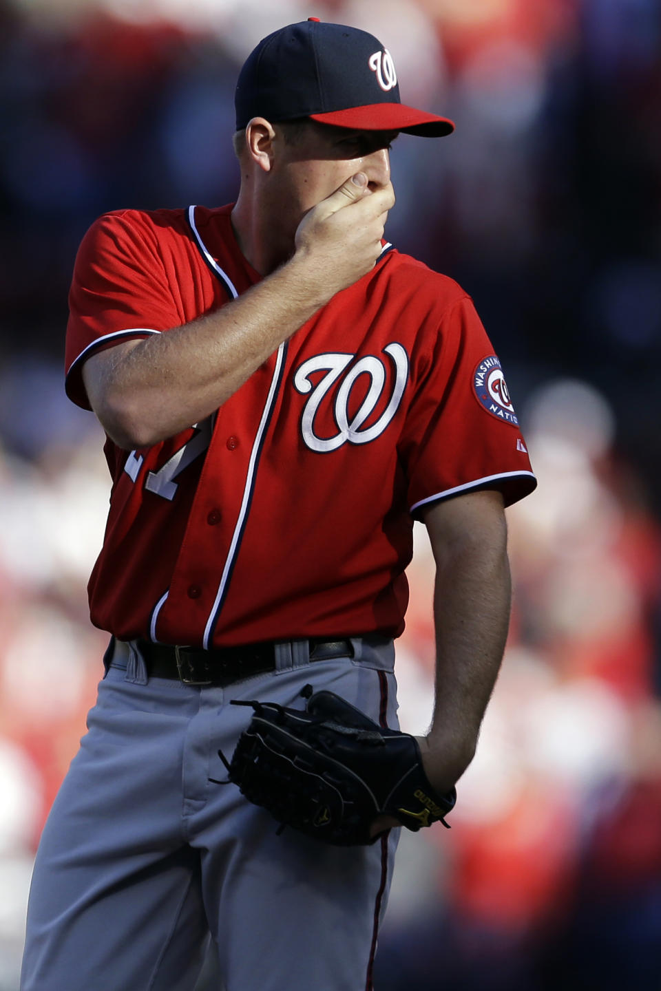 Washington Nationals starting pitcher Jordan Zimmermann stands on the mound after giving up a double to St. Louis Cardinals' David Freese during the second inning in Game 2 of baseball's National League division series, Monday, Oct. 8, 2012, in St. Louis. (AP Photo/Jeff Roberson)