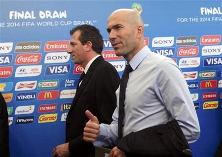 Former France soccer player Zinedine Zidane arrives for the draw for the 2014 World Cup at the Costa do Sauipe resort in Sao Joao da Mata