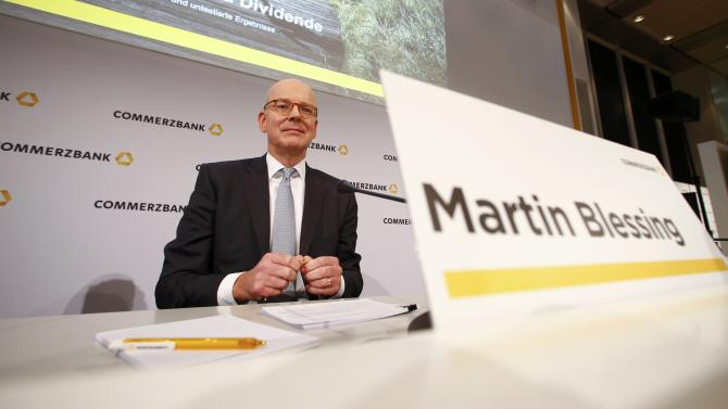 Commerzbank Chief Executive Blessing poses before the bank's annual news conference in Frankfurt