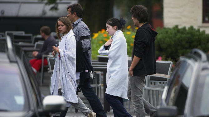 Teenagers who were attending a Labour Party youth wing summer camp on the Utoya island arrive at the Sunvold Hotel, Sundvollen, Norway Saturday July 23, 2011. A Norwegian gunman disguised as a police officer beckoned his victims closer before shooting them one by one, claiming at least 84 lives, in a horrific killing spree on an idyllic island teeming with youths that has left this peaceful Nordic nation in mourning. The island tragedy Friday unfolded hours after a massive explosion ripped through a high-rise building housing the prime minister's office, killing seven people.(AP Photo/Scanpix/Bjern Larsson Rosvall)