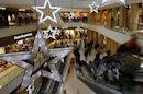 People walk through a shopping mall in the western Austrian city of Innsbruck