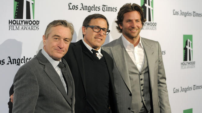 "Robert De Niro, left, recipient of the Hollywood Supporting Actor Award, David O. Russell, center, recipient of the Hollywood Director Award, and Bradley Cooper, recipient of the Hollywood Actor Award, pose together at the 16th Annual Hollywood Film Awards Gala on Monday, Oct. 22, 2012, in Beverly Hills, Calif. Russell directed De Niro and Cooper in the forthcoming film ""Silver Linings Playbook."" (Photo by Chris Pizzello/Invision/AP)"