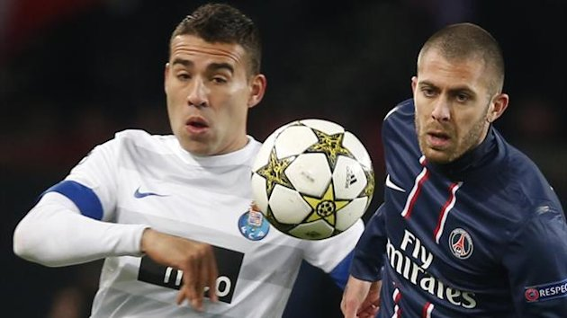 Paris St Germain's Jeremy Menez (R) challenges FC Porto's Nicolas Otamendi during their Champions League  match at Parc des Princes stadium in Paris