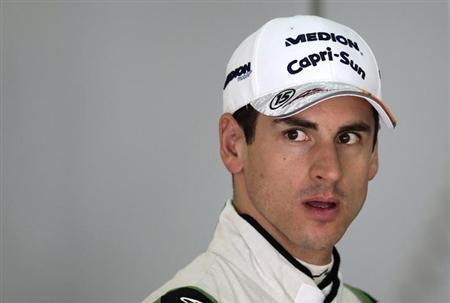 Formula One driver Adrian Sutil of Germany walks in the garage during the first practice session of the Malaysian F1 Grand Prix at Sepang International Circuit outside Kuala Lumpur, March 22, 2013. RE