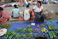 Vegetable vendors at a market in Myitkyina, Kachin province. A group of four Kachin businessmen led by a prominent jade tycoon have brokered multiple rounds of negotiations since November, seeking an elusive ceasefire, following a presidential order to the army to stop fighting