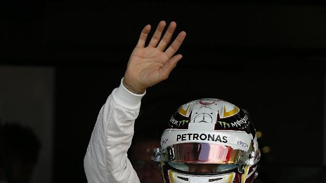 Mercedes driver Lewis Hamilton of Britain waves to the crowd ahead of qualifying ahead of the British Grand Prix at the Silverstone Race Circuit, Britain, July 4, 2015.(Phil Noble/Pool Photo via AP)
