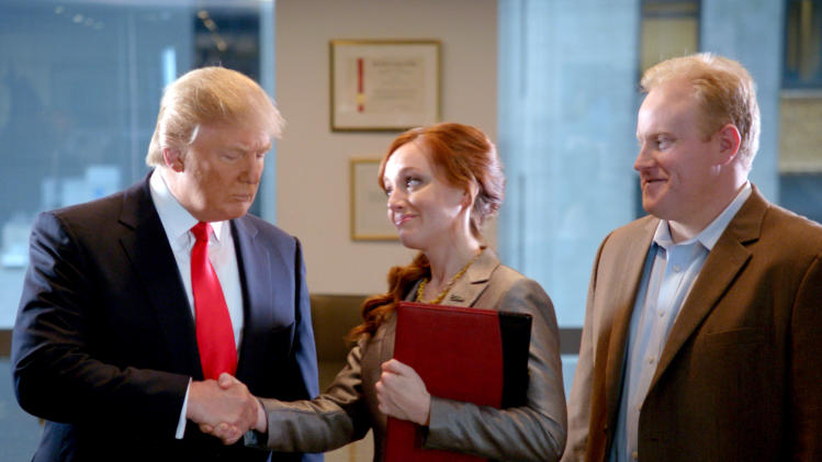 "This advertisement provided by Century 21, shows a scene from the ad ""Smarter, Bolder, Faster,"" with a Century 21 saleswoman and real estate tycoon Donald Trump, left. The ad will air during Super Bowl XLVI, Sunday, Feb. 5, 2012. (AP Photo/Century 21)"