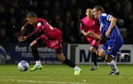 Nahki Wells, left, has set his sights on being League Two's leading scorer
