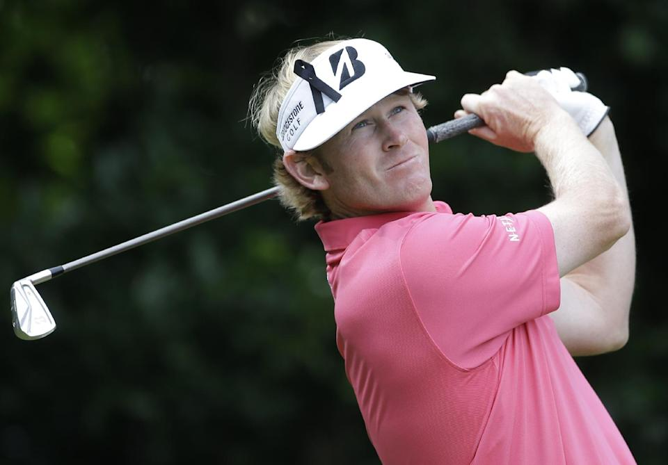 Brandt Snedeker of the United States plays a shot off the first tee at Royal Lytham & St Annes golf club during the third round of the British Open Golf Championship, Lytham St Annes, England, Saturday, July 21, 2012. (AP Photo/Peter Morrison)