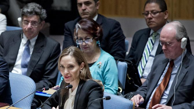 """In this photo provided by the United Nations, actress Angelina Jolie makes her debut before the Security Council at the U.N. headquarters as a special envoy for refugees to urge the world's nations to make the fight against rape in war a top priority, Monday June 24, 2013. Jolie, a goodwill ambassador for the U.N. high commissioner for refugees, said the Security Council has witnessed 67 years of wars and conflict since it was established """"but the world has yet to take up warzone rape as a serious priority."""" (AP Photo/United Nations, Rick Bajornas)"""
