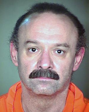 FILE-This undated file photo provided by the Arizona Department of Corrections shows inmate Joseph Rudolph Wood. A federal judge is expected to make a decision Friday, July 11, 2014 on whether to stop the execution of Wood a condemned Arizona inmate amid questions about the drug combination the state plans to use. (AP Photo/Arizona Department of Corrections,File)