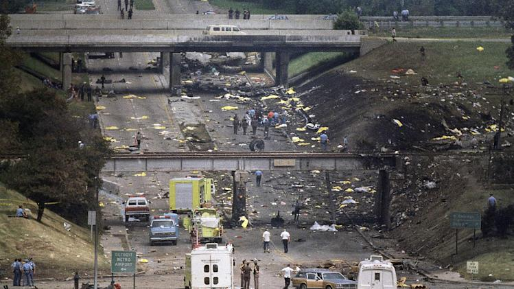 "FILE - In this Aug. 16, 1987 file photo, bag-covered bodies are strewn across the hillsides flanking Middlebelt Road in Romulus, Mich., after a Northwest Airlines MD-80, bound for Phoenix, crashed shortly after takeoff from Detroit Metropolitan Airport. In the new documentary, ""Sole Survivor,"" Cecelia Cichan, whose married name is Crocker, at age 4 was the lone survivor of the crash that killed 154 people aboard and two on the ground breaks her silence, discussing how the crash of the Phoenix-bound jetliner has affected her. (AP Photo/Dale Atkins, file)"