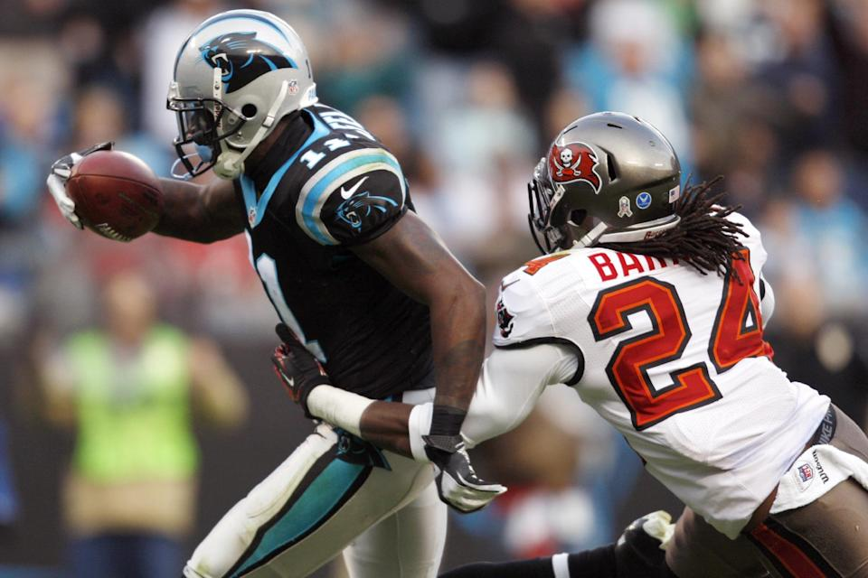 Carolina Panthers' Brandon LaFell (11) runs into the end zone for a tocuhdown as Tampa Bay Buccaneers' Mark Barron (24) defends during the second half of an NFL football game in Charlotte, N.C., Sunday, Nov. 18, 2012. (AP Photo/Nell Redmond)