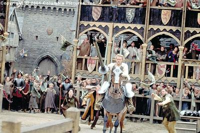Amid the adrenaline-charged cries of spectators-including (from left to right, background) Kate ( Laura Fraser ), Chaucer ( Paul Bettany ) and Roland ( Mark Addy ), aspiring knight William ( Heath Ledger , foreground) rides into fame in the Columbia Pictures presentation, A Knight's Tale