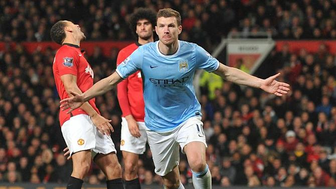 In this picture taken on March 25, 2014, Manchester City's Bosnian forward Edin Dzeko celebrates after scoring the second goal during the English Premier League football match against Manchester United at Old Trafford