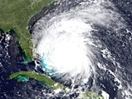 n this handout satellite image provided by the National Oceanic and Atmospheric Administration (NOAA), shows Hurricane Irene on August 25, 2011 in the Caribbean Sea.