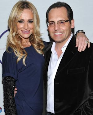 """FILE - In this Feb. 5,2011 file photo, television personality Taylor Armstrong, left, and husband Russell Armstrong attend a Super Bowl party in Dallas, Texas. Russell Armstrong, the estranged husband of """"Real Housewives of Beverly Hills"""" star Taylor Armstrong, has been found dead in his Los Angeles home. (AP Photo/Evan Agostini,File)"""