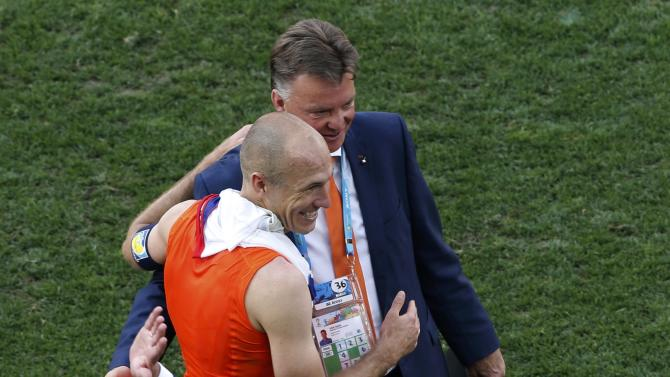 Arjen Robben of the Netherlands hugs coach Louis van Gaal after the 2014 World Cup Group B soccer match between Netherlands and Chile at the Corinthians arena in Sao Paulo
