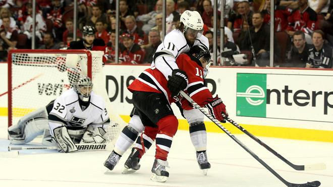 Stephen Gionta #11 Of The New Jersey Devils Goes For A Loose Puck Against Anze Kopitar #11 Of The Los Angeles Kings Getty Images
