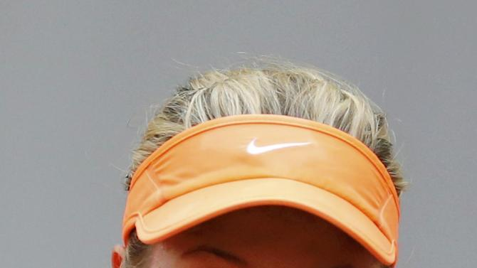 Bouchard of Canada eyes the ball during her women's singles match against Peer of Israel at the French Open tennis tournament at the Roland Garros stadium in Paris