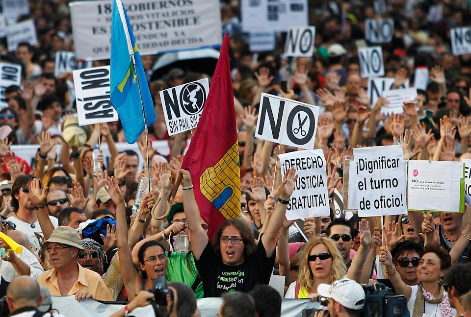 Protesters carry banners against financial cuts and unemployment as they demonstrate against the country's near 25 percent unemployment rate and stinging austerity measures introduced by the government, in Madrid, Spain, Saturday, July 21, 2012. (AP Photo/Andres Kudacki)