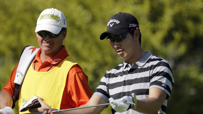 Sang-Moon Bae, of South Korea, looks at his club on the sixth hole in the second round of the Northern Trust Open golf tournament at Riviera Country Club in the Pacific Palisades area of Los Angeles Friday, Feb. 15, 2013. (AP Photo/Reed Saxon)